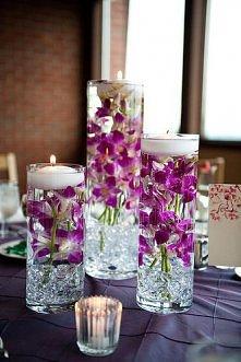Świeczki z kwiatami w wodzie