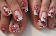 small flowers on a classic French manicure