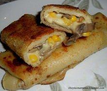 Naleśniki z pieczarkami, kukurydzą i serem.  Potrzebujemy: - 500 g pieczarek - 600 g sera - pół puszki kukurudzy - mleko - mąka - jajka - bułka tarta   Smażymy naleśniki. Piecza...