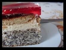 Składniki na ciasto: 1 szklanka maku 1 szklanka białek 1 szklanka cukru 1 szklanka mąki 1 kostka margaryny 2 łyżki kokosu 1 1/2 łyżeczki proszku do pieczenia  Dodatkowo: 1/2 szk...