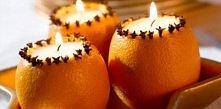 na stół można dodać własnoręcznie zrobione świeczniki z pomarańczy