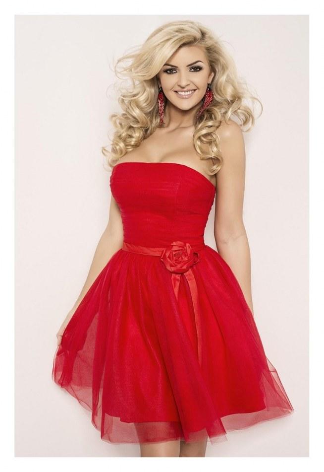 Dżersejowa sukienka bez ramiączek. Elastyczna talia i wewnętrzny top z elastycznym brzegiem u góry.