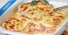 LASAGNA z chleba   składniki:  1 opakowanie chleba tostowego Śmietana 1 cebula  3 ząbki czosnku  1/2 kg sera mozzarella  1/2 kg szynki   Jak przygotować  W rondlu na odrobinę ol...