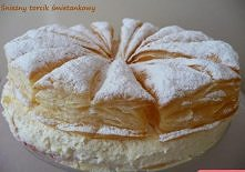Śnieżny torcik   Składniki: 2 opakowania mrożonego ciasta francuskiego 2 łyżki cukru 200 g powideł śliwkowych 2 cukry waniliowe (po 16 g) opakowanie śmietan-fix ½ l śmietany kre...