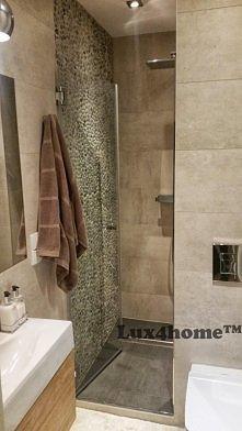 Otoczaki pod prysznicem. Ko...