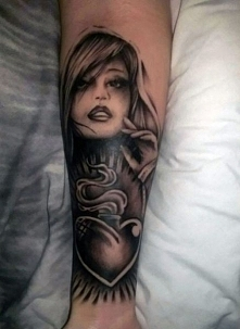 woman and heart tattoo