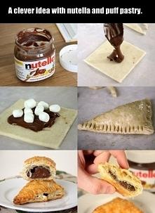 Ciasto francuskie pokroić w kwadraty. Na środek nałożyć nutellę i posypać mini piankami. Dokładnie skleić ciasto widelcem, zapiec.