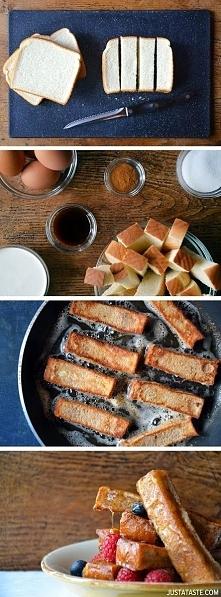 cynamonowe pałeczki tostowe:) -chleb tostowy (8 kromek) -4 duże jajka -śmietana kremówka -2 1/2 łyżeczki cynamonu -1 łyżka cukru -1 łyżeczka ekstraktu z wanilii -masło -syrop kl...