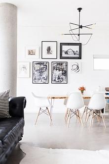 Open space w designerskim wydaniu. Krzesła Eames, kanapa chesterfield, beton ...
