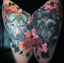 tatuaże na udzie wilki