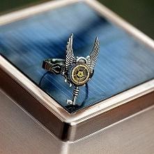 Pierścionek z kluczem *Q*