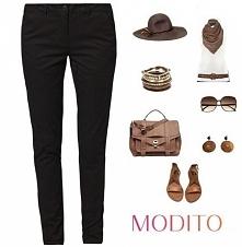Czarne spodnie ze złotymi zamkami. Po kliknięciu w zdjęcie więcej szczegółów.