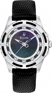 piękny zegarek z diamentami, perłowa tarcza mieniąca się kolorami zieleni, granatu i czerni