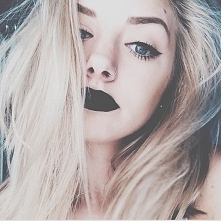 a girl with black lips