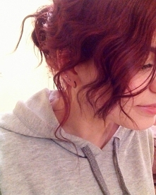 curly red hair and piercing