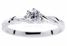 Urzekający pierścionek z brylantem 0,17 ct z oryginalną szyną w kształcie skr...