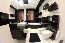 Nowoczesna, ciemno-biała łazienka o specyficznym, ale bardzo eleganckim stylu z meblami łazienkowymi przygotowanymi na wymiar. Mieszkanie w Bydgoszczy.