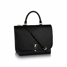 Czarna mała torebka Lv. :)