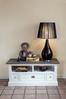 Biała szafka RTV z kolekcji Olsen wykonana z drewna dębowego. Cała kolekcja o...