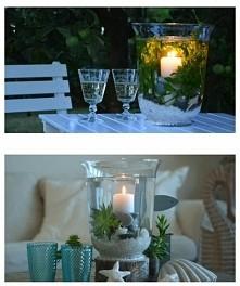 Potrzebne będą dwa szklane wazony. Drugi musi być węższy, tak aby zmieścił się do pierwszego. Świeczka, dekoracyjne kamienie, muszelki lub inne cudai rośliny (mogą być sztuczne...