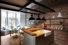kuchnia a'la loft połączona z eleganckim salonem
