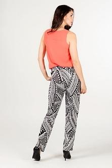 Wzorzyste wygodne spodnie damskie z cienkiej tkaniny. W talli wszyta guma i d...