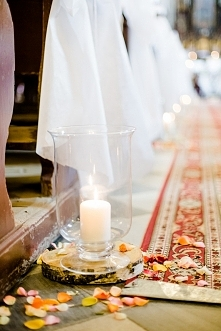 Candles and petals in church, wedding ceremony.