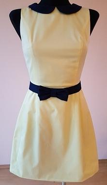 Żółta, taliowana sukienka z ozdobną kokardką. Rozmiar 36.