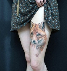 fox tattoo on thigh