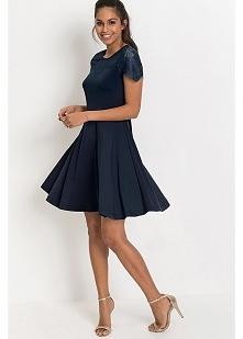 Granatowa sukienka z dżerse...