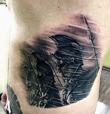 spartan tattoo on ribs