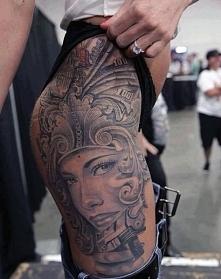 women thigh face tattoo
