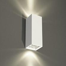 Kinkiet lampa ścienna OZU - dostępna w =mlamp=  Lampa posiada prostą formę w kształcie prostokąta. Oświetlenie wykonane jest z metalu w białym kolorze. Lampa posiada miejsce na ...