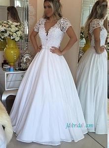 Biała suknia ślubna księżni...