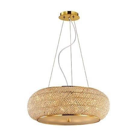 PASHA SP10 55cm IDEAL LUX LAMPA WISZACA 082257 ZŁOTO    Ekskluzywna lampa wisząca składająca się ze stalowej ramy oraz ciętych luksusowych kryształków sprawiających, że produkt ten wyróżnia się na tle innych. Emituje spokojnym przytłumionym światłem efektownie wydobywającym się spod dekoracji lampy.