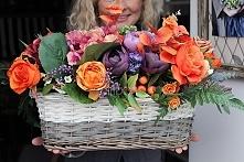 kosze pełne jesiennych kwia...