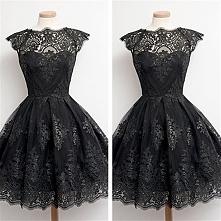 Przepiękna, koronkowa sukienka do kolan, z cudownie zdobionym dekoltem. Klikn...