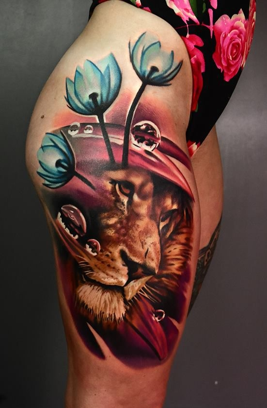 lion and flower tattoo on hips