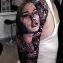 woman with snakes tattoo