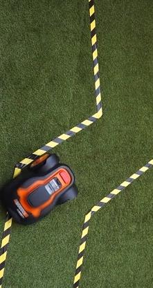Instalacja automatycnzego robota koszącego w ogrodzie