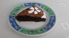 Brownie z przepisu Ewy Wachowicz  SKŁADNIKI      200 g - gorzkiej czekolady     200 g - masła     6 - jajek     300 g - cukru     100 g - mąki     orzechy włoskie     lody wanil...