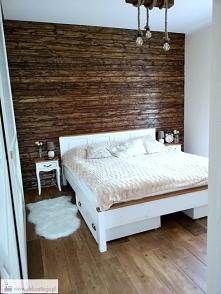 Sypialnia pełna drewna i pr...