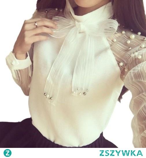 Elegancka bluzka damska idealna do pracy, na świąteczną kolację bądź randkę. Zdobiona perełkami oraz unikatowym wiązaniem pod szyją. Kliknij w zdjęcie i zobacz gdzie kupić!