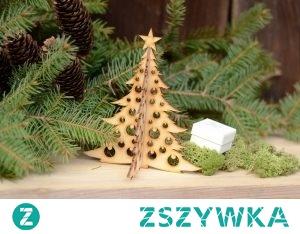 Choinka składana z bombkami.  Choinka składana z wyciętymi bombkami – stojąca bożonarodzeniowa ozdoba. Może być wykorzystana jako stojak na kolczyki oraz do dekoracji świątecznych stroików. Choinka składana jest dostępna także z wyciętymi gwiazdkami.