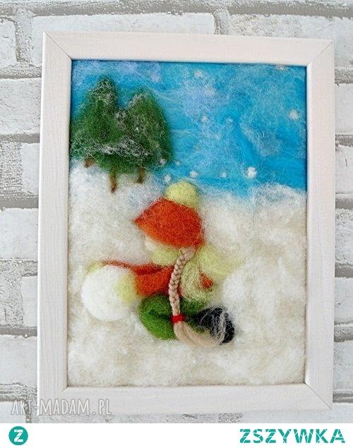 Dziewczynka lepiąca bałwana. Obraz z kolekcji Winter.