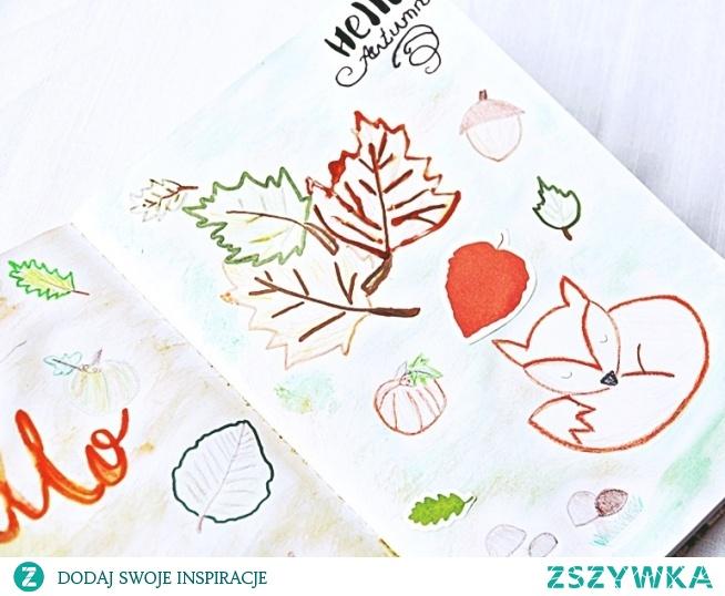Rozkładówka jest wykonana mieszanką różnych technik: rysunku, malowania farbami akwarelowymi, wyklejania i hand letteringu.