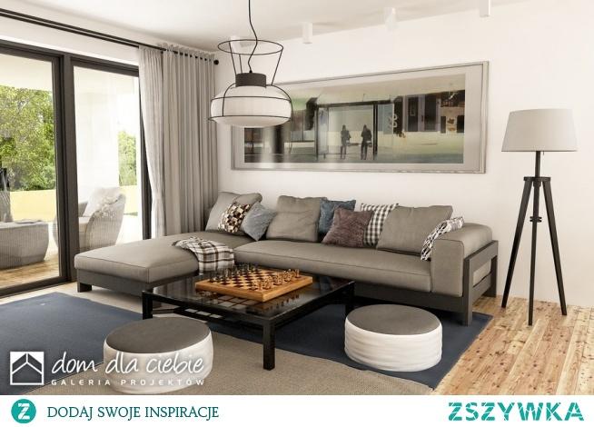 Pogodna to projekt optymalnego domu jednorodzinnego dla 3-4osobowej rodziny. Strefa wejściowa przed domem oraz dwustanowiskowy garaż stanowią spójna całość w strefie wejściowej. Budynek ozdobiony jest detalami w naturalnych kolorach - cegłą oraz jasnym drewnem. W środku zaprojektowano trzy sypialnie, przestronną przestrzeń salonu, kuchni i jadalni. Widok salonu.