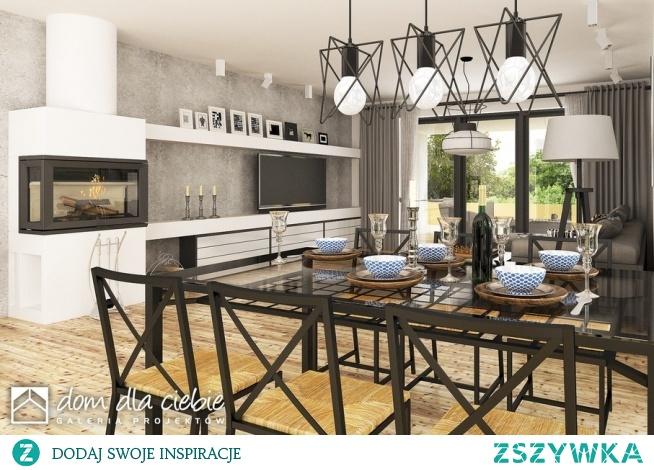 Pogodna to projekt optymalnego domu jednorodzinnego dla 3-4osobowej rodziny. Strefa wejściowa przed domem oraz dwustanowiskowy garaż stanowią spójna całość w strefie wejściowej. Budynek ozdobiony jest detalami w naturalnych kolorach - cegłą oraz jasnym drewnem. W środku zaprojektowano trzy sypialnie, przestronną przestrzeń salonu, kuchni i jadalni. Widok jadalni.