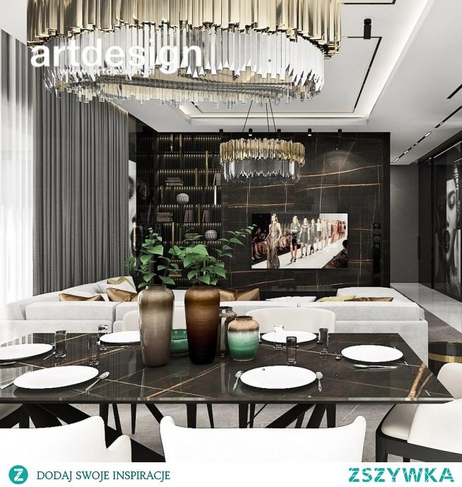 Projekt salonu połączonego z jadalnią. Kontrastowa kolorystyka, wyraziste faktury materiałów, dekoracyjne lampy - to tylko niektóre elementy tego pięknego, luksusowego wnętrza.   FULL STEAM AHEAD!   Nowoczesny dom