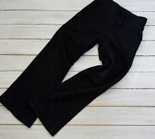 Sprzedam spodnie dresowe dziewczęce firmy GEORGE. Rozmiar: 7-8L/ 122-128cm.  Opis  W pasie szeroka guma  Atrapa sznureczka  Lekko rozszerzane w dole  Wymiary:  Długość - 74cm;  ...